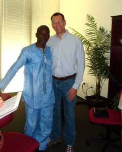 Brad at OIE presentation in Togo garments 2012 sm